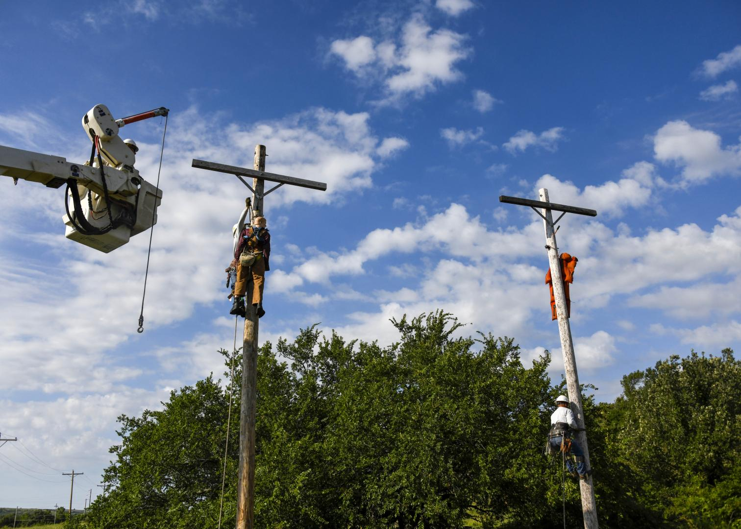 Three Bluestem linemen work together to learn about pole top rescue